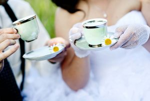 Bride and groom drinking tea in nature